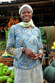 African Woman Selling Fruit at Local Market
