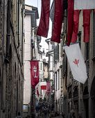 Street Covered With Flags In Old Town Of Bergamo, Italy