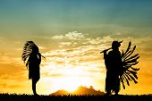 stock photo of apache  - an illustration of two Indians playing music at sunset - JPG