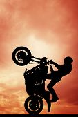 Stuntman Motorcyclist At Sunset