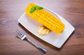 Cooked corncob on the plate