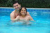 Son And Dad Enjoying Pool