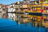stock photo of houseboats  - Floating Home Village Yellow Brown Houseboats Fisherman - JPG