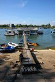 foto of scrappy  - Houses and scrappy pontoon bridge on Sava riverBelgradeSerbia - JPG