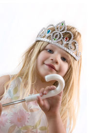 stock photo of toddlers tiaras  - A small blond girl wearing a princess tiara.