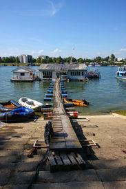 picture of scrappy  - Houses and scrappy pontoon bridge on Sava riverBelgradeSerbia - JPG