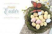 Happy Easter Shabby Chic Table With Speckled Birds Eggs And Butterfly In Nest With Spring Blossoms A