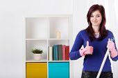 Smiling Woman During Housework