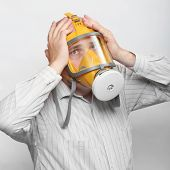 Unhappy man in protection mask. Allergy concept.