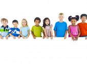 stock photo of brother sister  - Group of Children Standing Behind Banner - JPG