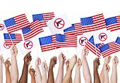 Diversity of Hands Holding Gun Control and American Flags