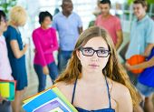Sad Student with Glasses Holding Books