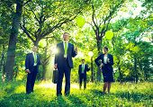 Group of Business People Holding Green Balloons in Nature