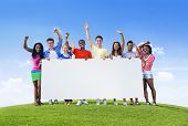 Young People Celebrating with Blank Billboard