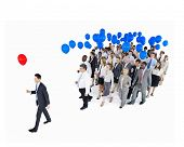 Businessman Standing Out From Crowd with Red and Blue Balloons