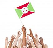 picture of burundi  - Diverse Multiethnic Hands Holding and Reaching For The Flag of Burundi - JPG