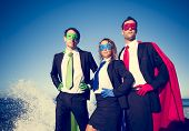 stock photo of superhero  - Superhero Business People at Stormy Ocean - JPG