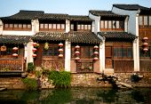 Traditional Chinese Houses Lining a Canal in Suzhou, China