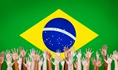 Multi-Ethnic Hands With Flag Of Brazil