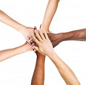 Multi-Ethnic Group Of People Stacking Their Hands Together