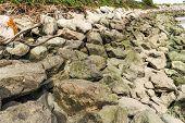 Breakwater Made Of Rocks Along A Shore