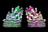 stock photo of ganesh  - The sculpture of Indian god Lord Ganesh on bkack background - JPG