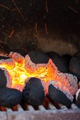 Charcoal Briquettes With Fire Sparks.