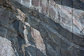 picture of gneiss  - At the right of this image there is a band of blueish grey gneiss - JPG