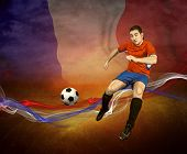 Abstract waves aroun soccer player on the national flag of France