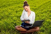 Young Woman, Girl Working With Laptop, Tablet And Phone In Green Field, Park