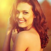 Beauty Sunshine Girl Portrait. Happy Woman Smiling.