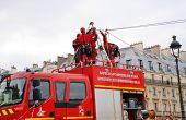 PARIS, FRANCE - MARCH 18, 2014: Firefighters of the elite GRIMP unit carry out a training exercise a