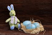 Easter Bunny Toy Raffia Nest Duck Eggs On Rough Background