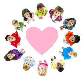 foto of pre-adolescent child  - Smiling Diverse Children Around a Heart - JPG