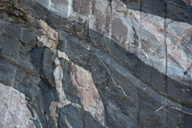 pic of gneiss  - At the right of this image there is a band of blueish grey gneiss - JPG