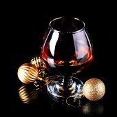 Glass With Drink And A Christmas Balls.