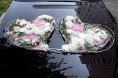 Wedding Car Decorated with Flowers in the form of two hearts.
