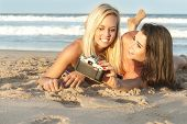 Young attractive lesbian couple having fun at beach
