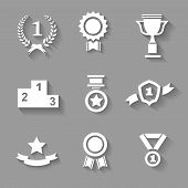 stock photo of rosettes  - Set of white vector award  success and victory icons with trophies  stars  cups  ribbons  rosettes  medals medallions  wreath and a podium on grey - JPG