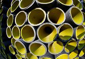 Yellow Corrugated Pipes In A Roadworks For Laying Optical Fiber For Telecommunications