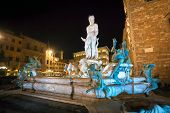 Illuminated Neptune Fountain In Florence