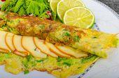 image of scallion  - Vegetarian scallion omelette bio eggs swiss cheese slised lime - JPG