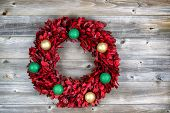 Natural Leaf Wreath, With Ornaments, For The Seasonal Holidays On Rustic Wood