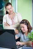 Asian Smile  Women Using Laptop Computer