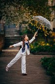 little girl dancing with lace ambrella