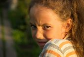 Closeup portrait of Scared and angry cute little girl. Domestic violence concept.