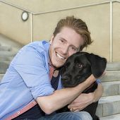 Happy Young Man With His Dog