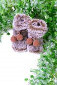 Snow boots with green tinsel