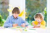 Two Kids Making colorful paper butterflies