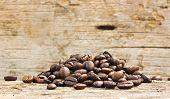 Coffee Grains On Grunge Wooden Background